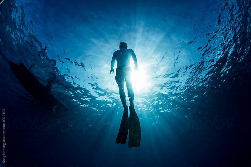 Freediving with sunlight by Song Heming for Stocksy United