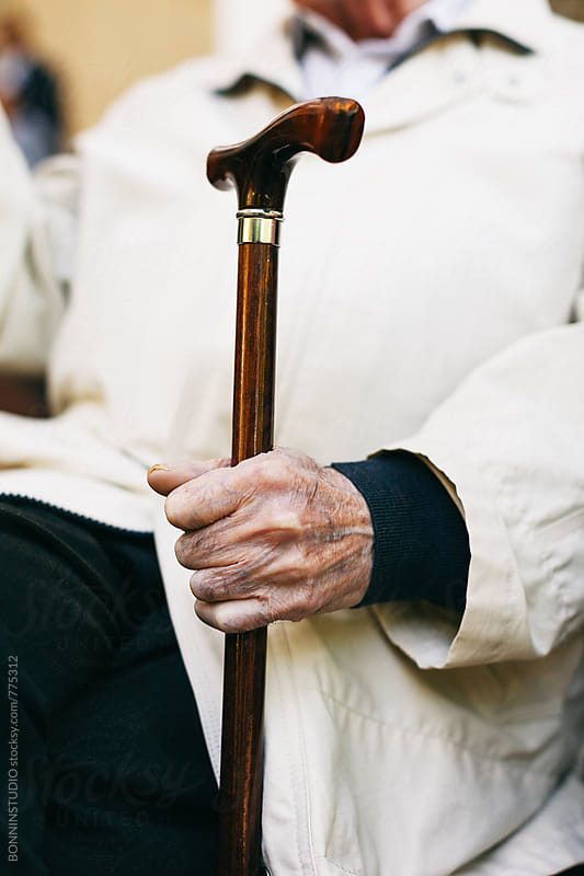 Hand of an elderly man holding a stick. by BONNINSTUDIO for Stocksy United