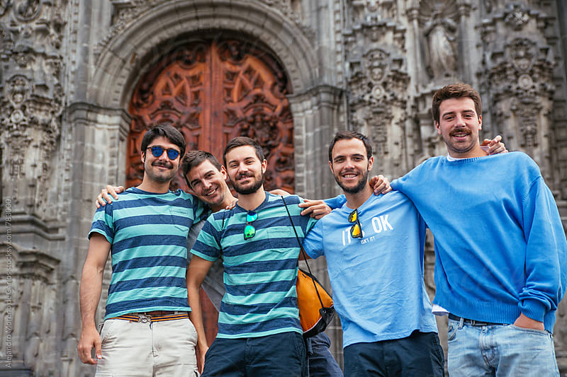 Group of young friends smiling in front of a cathedral  by Alejandro Moreno de Carlos for Stocksy United