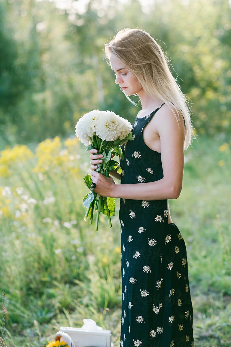 Beautiful girl in dress in field with bouquet of flowers stocksy beautiful girl in dress in field with bouquet of flowers by andrei aleshyn for stocksy united izmirmasajfo