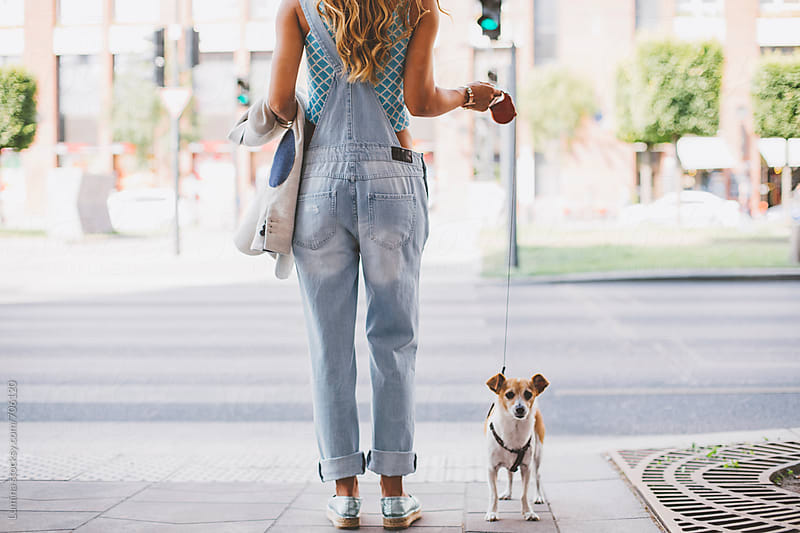 Blonde Woman Walking Her Dog by Lumina for Stocksy United