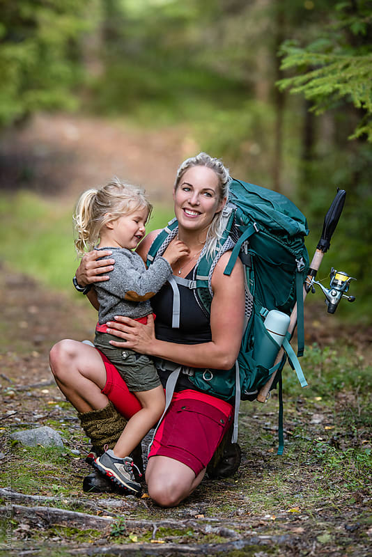 hiking mother and daughter by Andreas Gradin for Stocksy United
