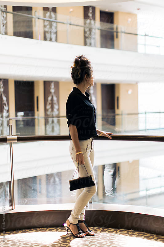 Woman Standing in a Shopping Mall by Mosuno for Stocksy United