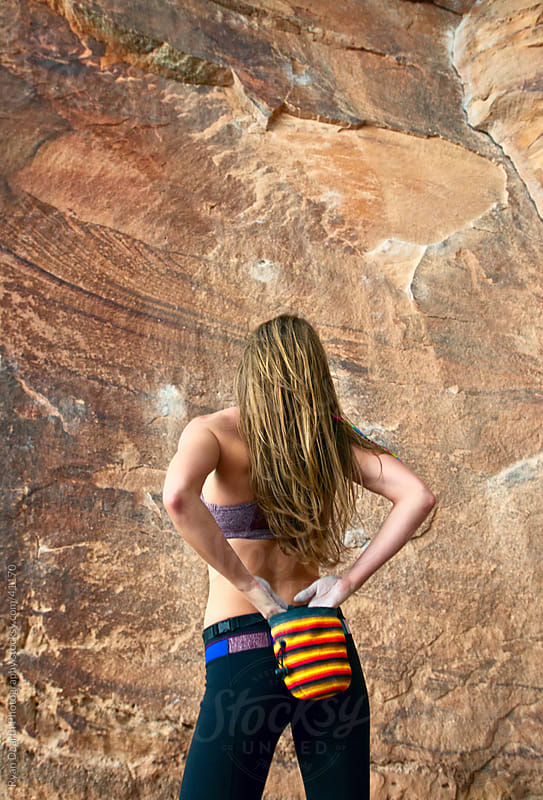 Girl Chalks Hands in Preparation to Rock Climb by Ryan Dearth Photography for Stocksy United