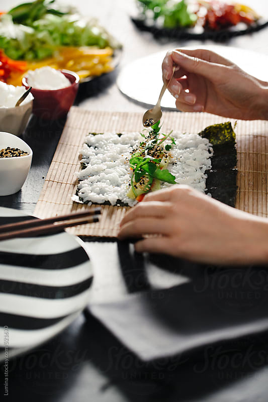 Woman Making Veggie Maki Sushi Rolls by Lumina for Stocksy United