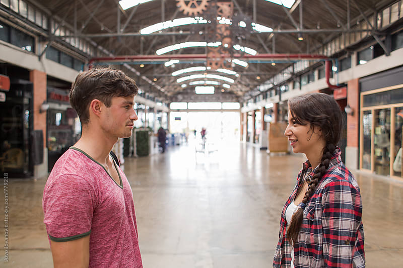 A couple of young people standing in front of each other by Jovo Jovanovic for Stocksy United