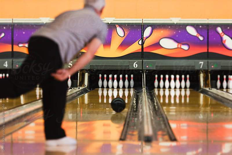 Bowling: Mature Bowler Just Released Ball Down Alley by Sean Locke for Stocksy United