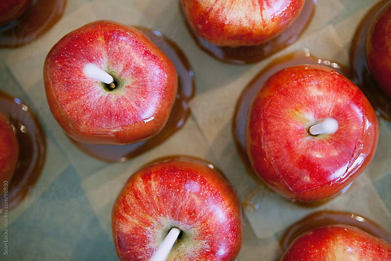 Apples: Overhead View of Dipped Caramel Apples by Sean Locke for Stocksy United