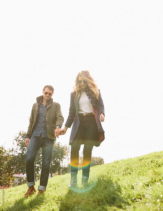 Young couple walking in city park by Trinette Reed for Stocksy United