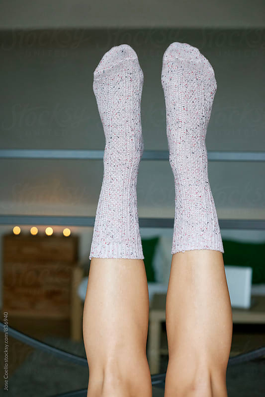 woman wearing socks by Jose Coello for Stocksy United