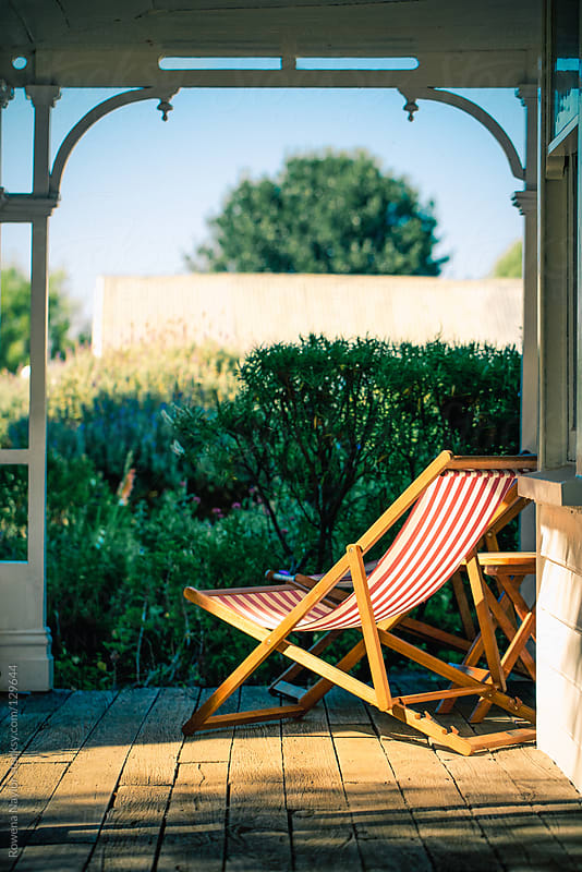 Empty Inviting Deckchair looking out onto Homestead Garden by Rowena Naylor for Stocksy United