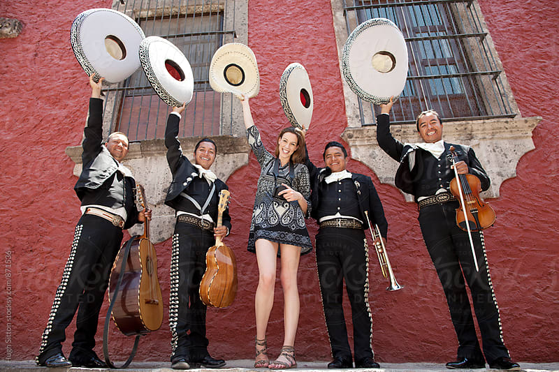 Female tourist with Mariachi Band. Mexico by Hugh Sitton for Stocksy United