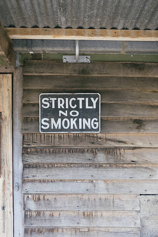 Vintage No Smoking sign in shed by Rowena Naylor for Stocksy United