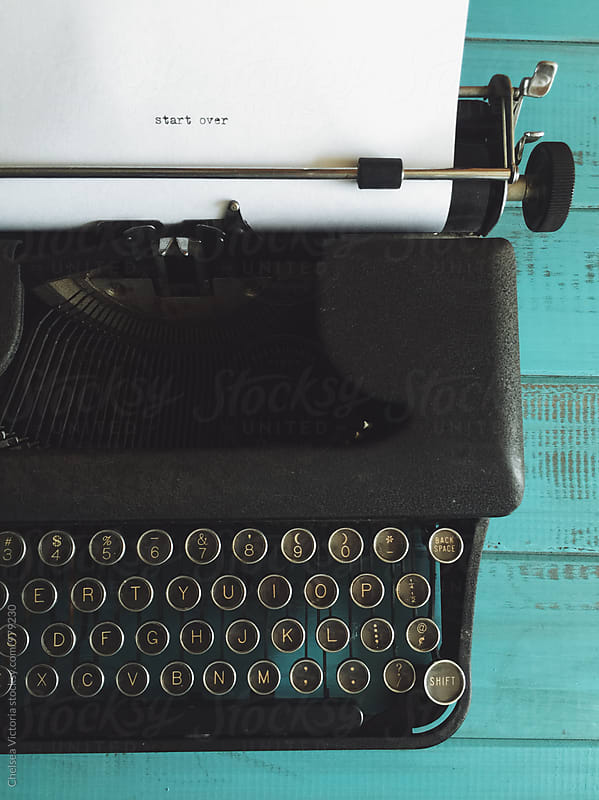 A vintage typewriter that says start over by Chelsea Victoria for Stocksy United