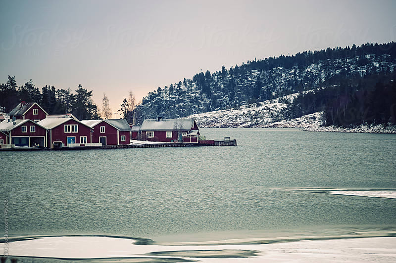 Little town in Sweden during winter by Simone Becchetti for Stocksy United