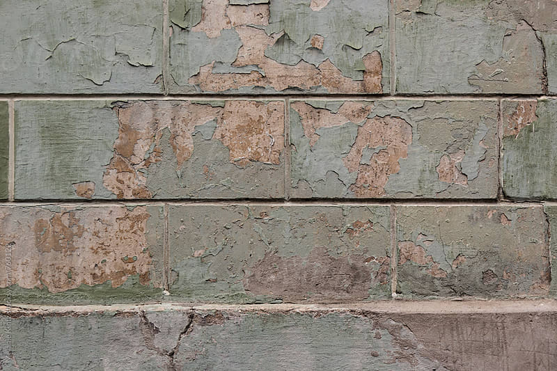 Stone wall with paint peeling off by Melanie Kintz for Stocksy United