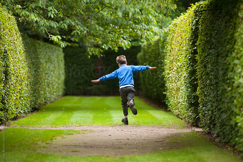 boy playing aeroplanes in the park by Lee Avison for Stocksy United