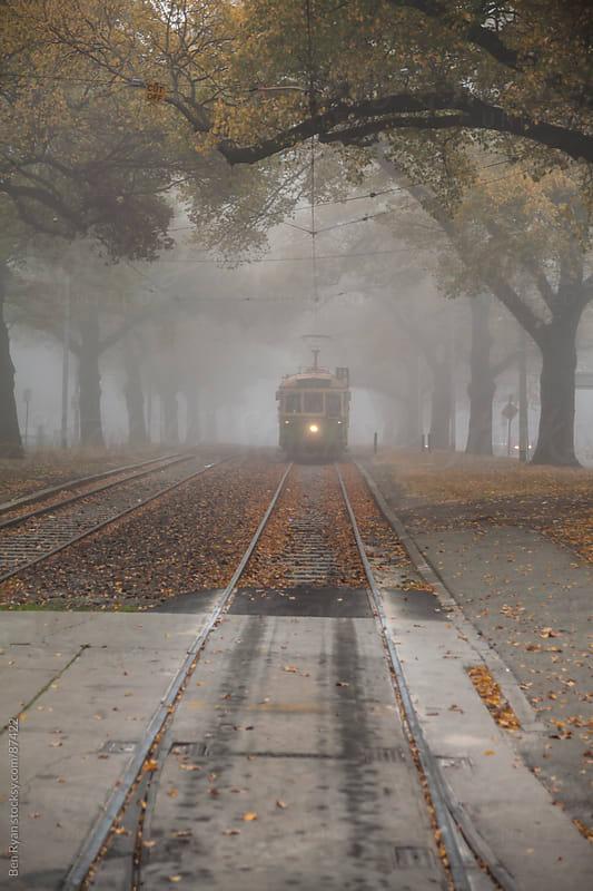 Vintage tram in a foggy autumn scene by Ben Ryan for Stocksy United