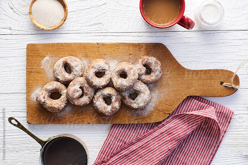 Homemade donuts with sugar and chocolate dipping sauce by Trinette Reed for Stocksy United