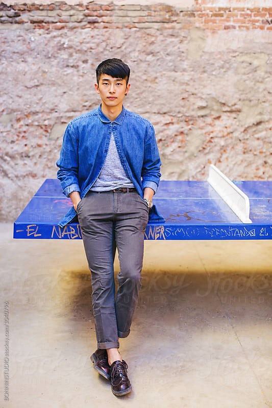 South Korean trendy man posing outdoors. by BONNINSTUDIO for Stocksy United