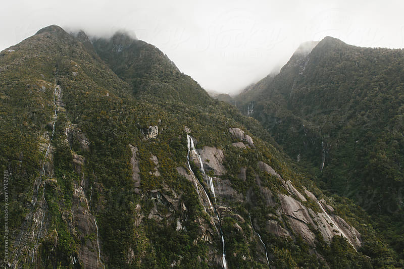 Cliff at Milford Sound, New Zealand by Cameron Zegers for Stocksy United