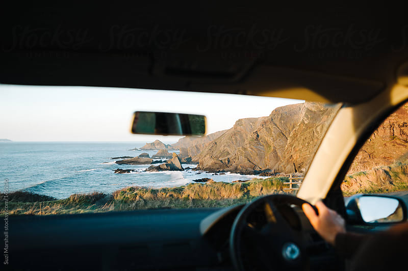 View of the coast through the windscreen of a parked car by Suzi Marshall for Stocksy United