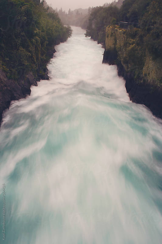The roaring Waikato River before it transforms into a stunning waterfall leading into Lake Taupo. by Kaat Zoetekouw for Stocksy United
