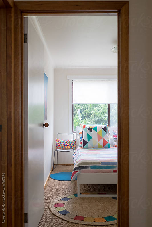 Looking through to colorful styled bedroom by Rowena Naylor for Stocksy United