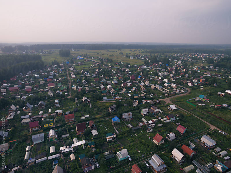 Bird's eye view of village in countryside by Danil Nevsky for Stocksy United
