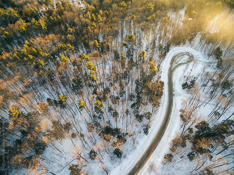 Drone image of a road during sunset in winter by Jen Grantham for Stocksy United