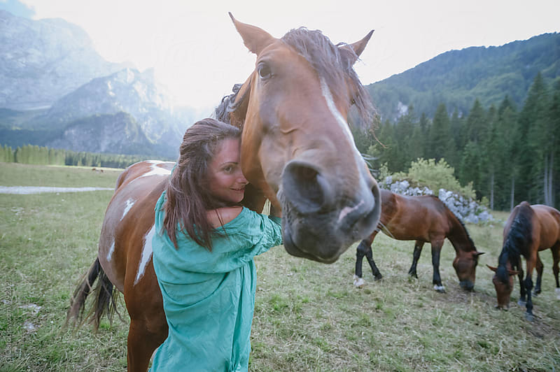 Woman with her horse enjoying outdoors by GIC for Stocksy United