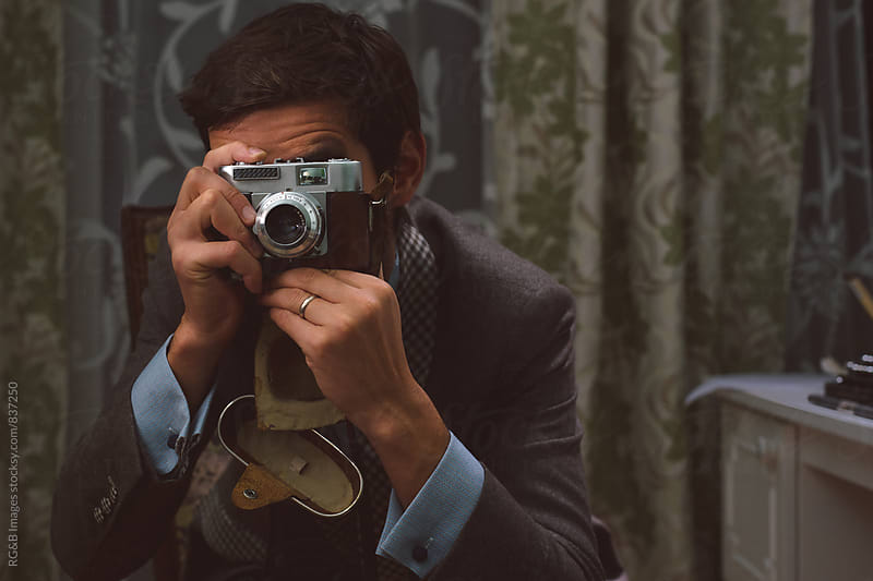 Stylish photographer taking a photo using a vintage camera by RG&B Images for Stocksy United
