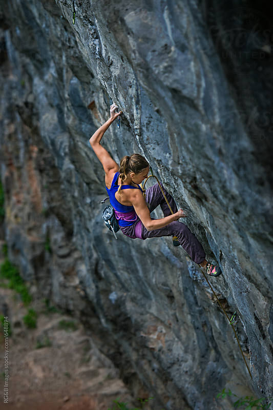 Fit young woman rock climbing a steep wall by RG&B Images for Stocksy United