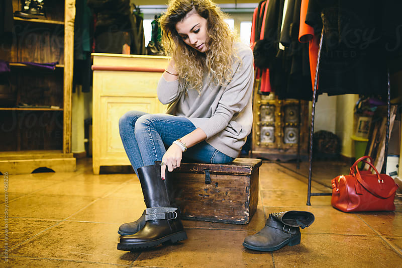 Woman trying out shoes in a store.  by michela ravasio for Stocksy United