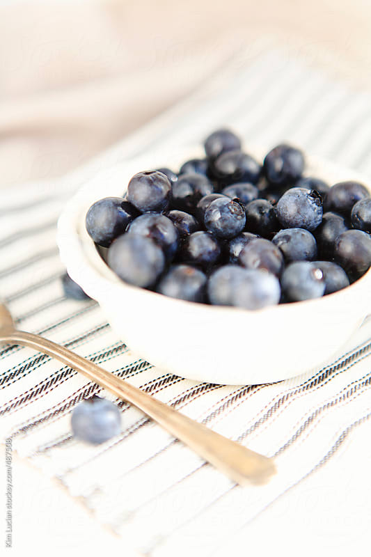 Blueberries in Bowl with Spoon by Kim Lucian for Stocksy United
