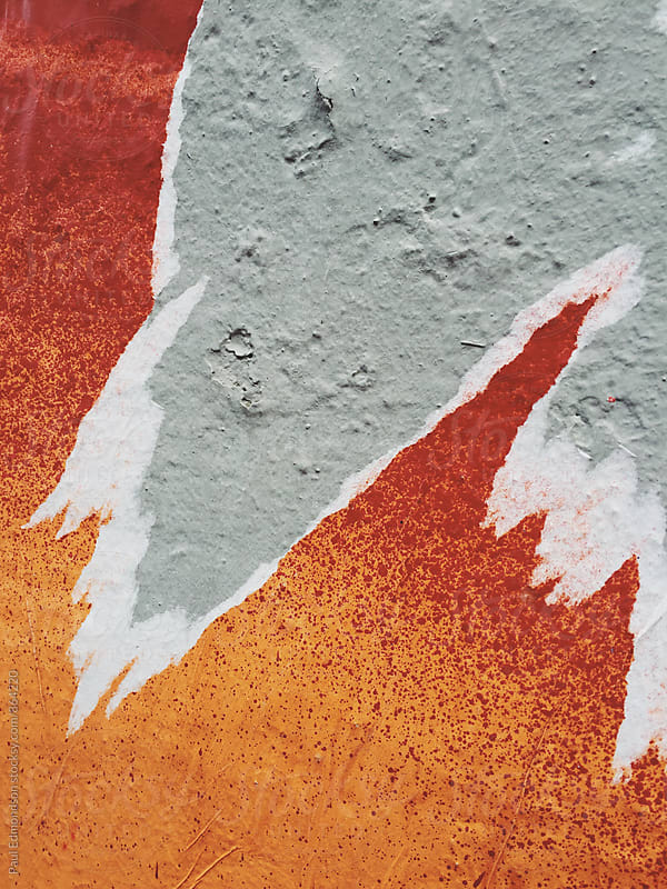 Close up of peeling posters on wall by Paul Edmondson for Stocksy United