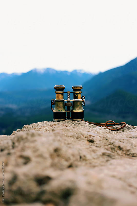 Binoculars on a Mountain Cliff Edge by Eric Bowley for Stocksy United