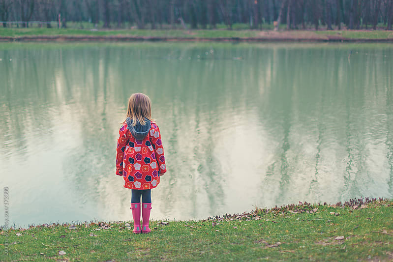 Girl Standing by the River by Lumina for Stocksy United
