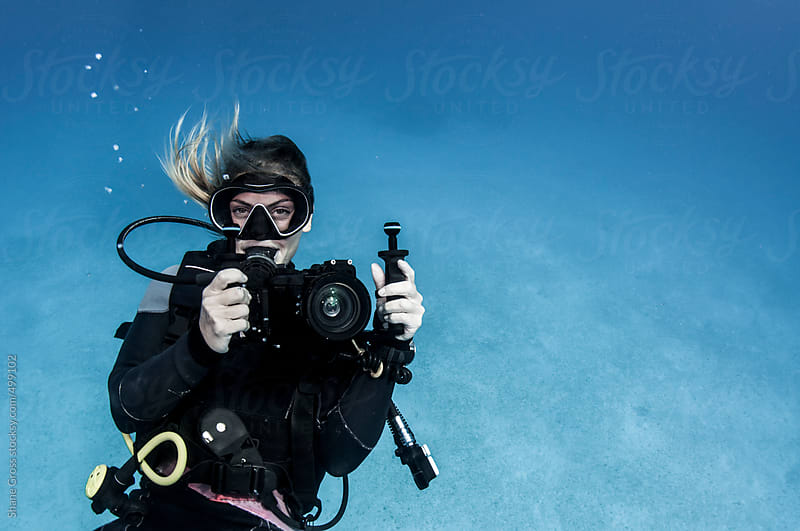 Young Woman Underwater Photographer by Shane Gross for Stocksy United