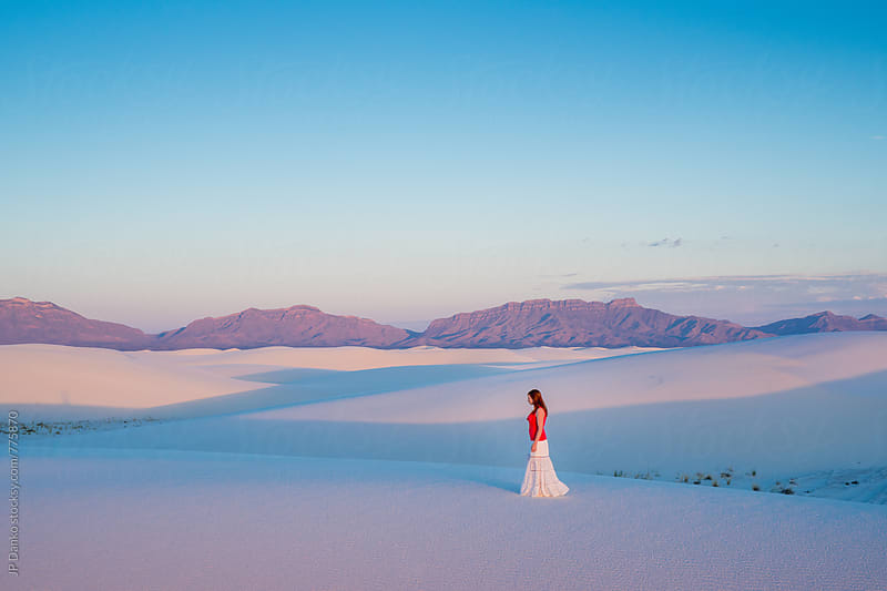 Woman In White Skirt Walking Barefoot on Sand Dunes In White Sands National Monument at Dawn by JP Danko for Stocksy United
