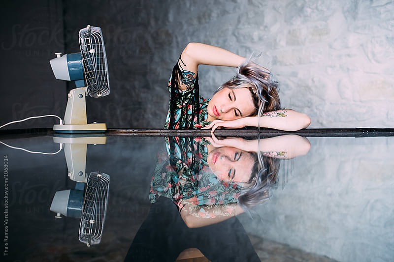 woman on a reflecting glass by Thais Ramos Varela for Stocksy United