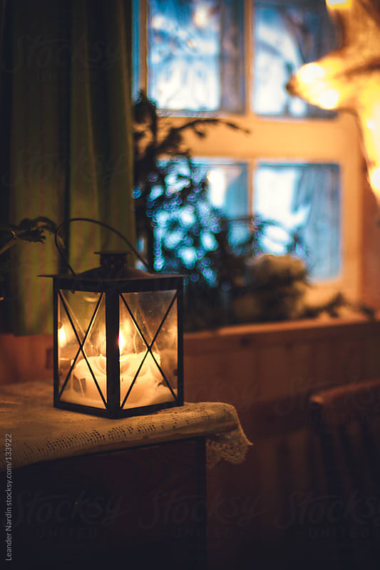 lantern in christmassy ambience by Leander Nardin for Stocksy United