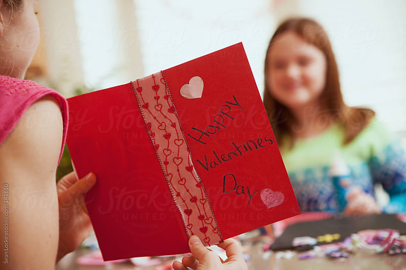 Valentine: Girl Showing Off Valentine Card by Sean Locke for Stocksy United
