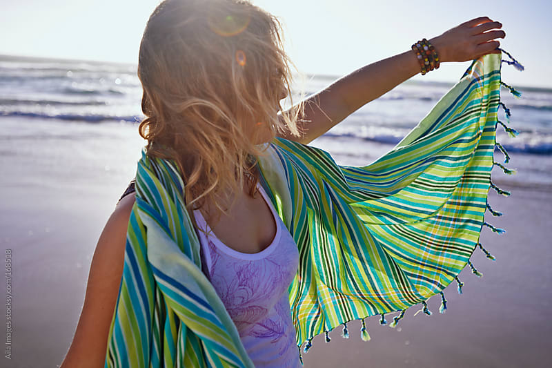 Beautiful Girl on the beach near sunset by Aila Images for Stocksy United