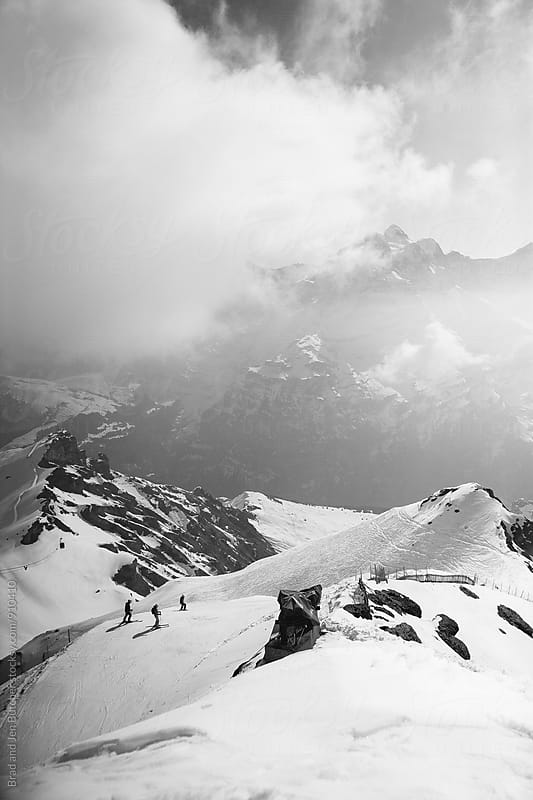 Skiers in Alps by Brad and Jen Butcher for Stocksy United
