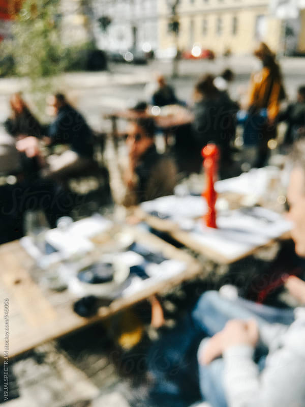 People Eating in Restaurant Defocused by VISUALSPECTRUM for Stocksy United