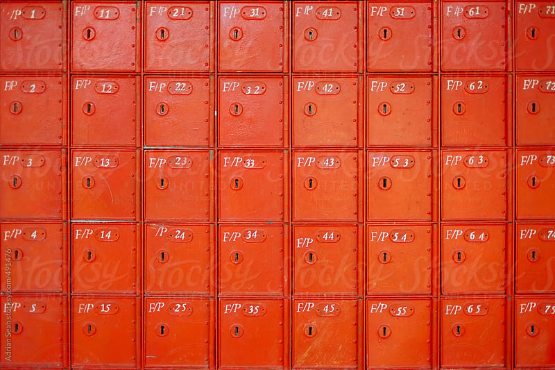 Bright red letter boxes by Adrian Seah for Stocksy United