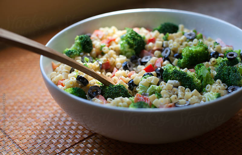Healthy pasta salad with broccoli, peppers and olives by Carolyn Lagattuta for Stocksy United