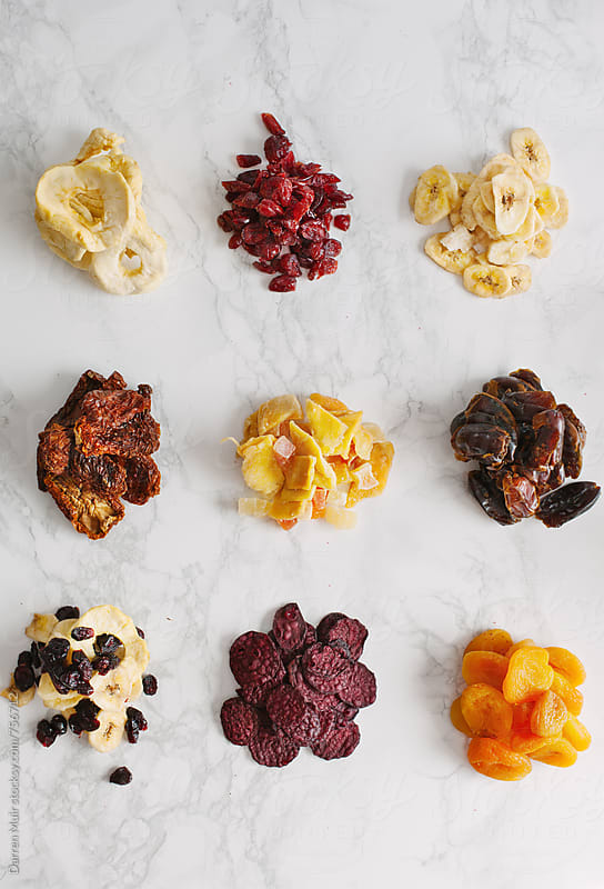 Dehydrated fruit and vegetables on a white background. by Darren Muir for Stocksy United