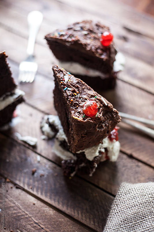 Slices of chocolate cake. by Darren Muir for Stocksy United